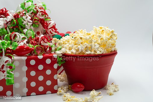 Christmas background red and white polkadot gift ribbon. Red bowl of popcorn overflowing.  Old fashion Christmas bulbs