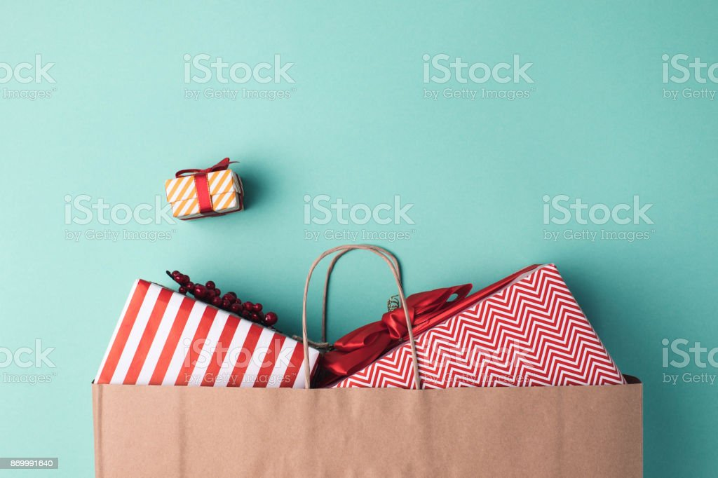 presents in paper bag stock photo