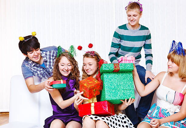 presents Teenage girls receiving holiday presents group of friends giving gifts to the birthday girl stock pictures, royalty-free photos & images
