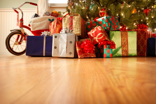 Presents under the Christmas tree in a home setting..To see more holiday images click on the link below: