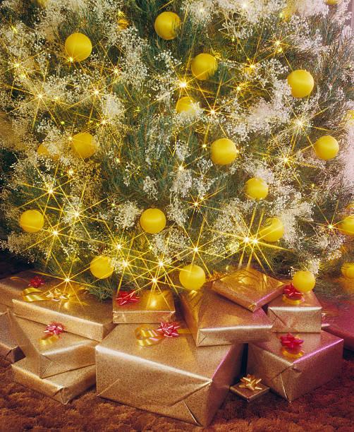 Presents under tree stock photo