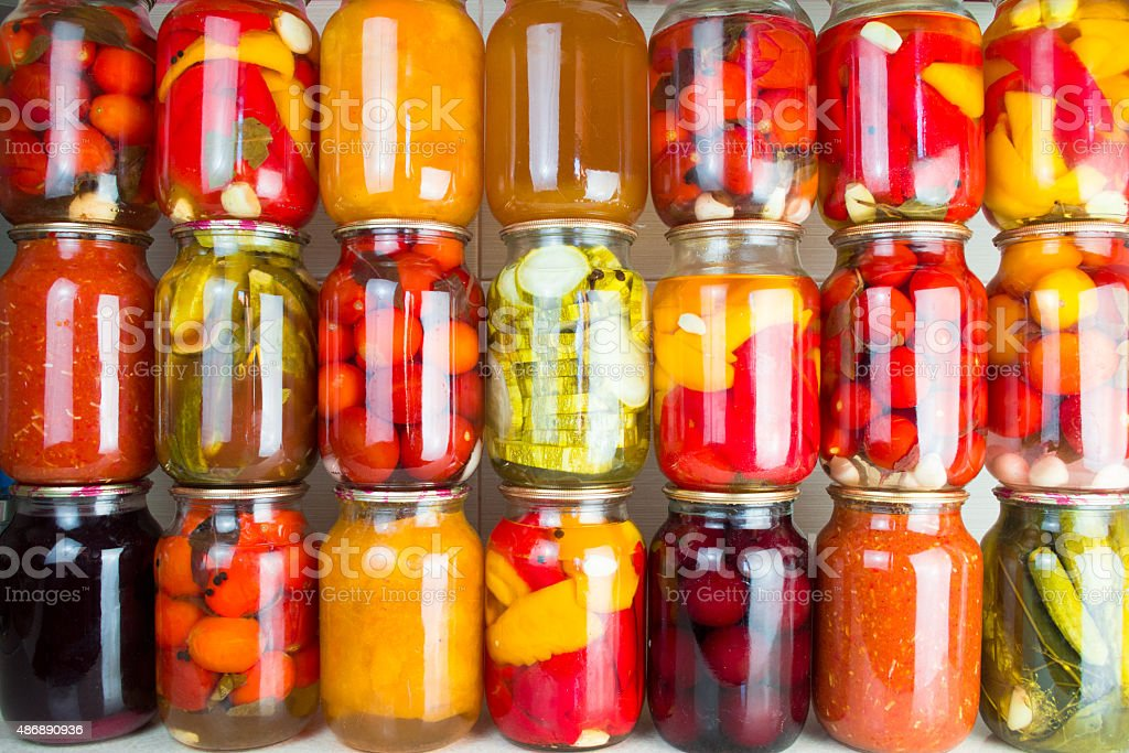 Preserved vegetables and food ingredients set in a row stock photo
