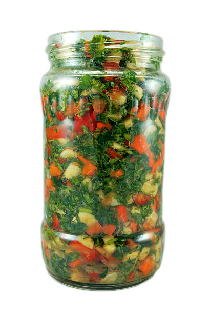 preserved vegetables in a jar stock photo