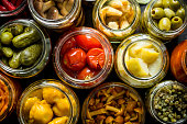 istock Preserved vegetables in glass jars. 1155951289