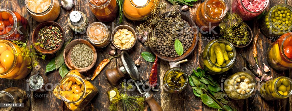 Preserved vegetables in glass jars with seamer. stock photo