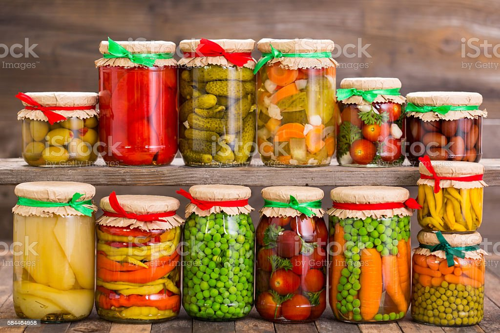 Preserved vegetables in the jars stock photo