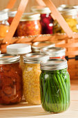 istock Preserving Fall Produce Vegetable Harvest with Home Canning Glass Jars 183427580