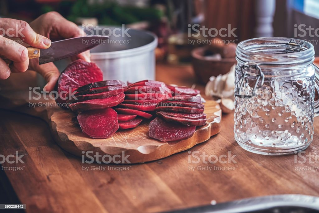 Preserving Organic Red Beet in Jars stock photo