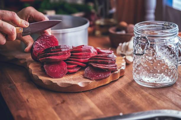 Preserving Organic Red Beet in Jars stock photo