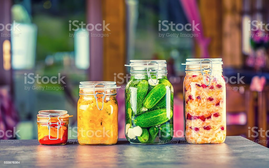 Preserving. Pickles jars. Jars with pickles, pumpkin dip, white cabbage. stock photo