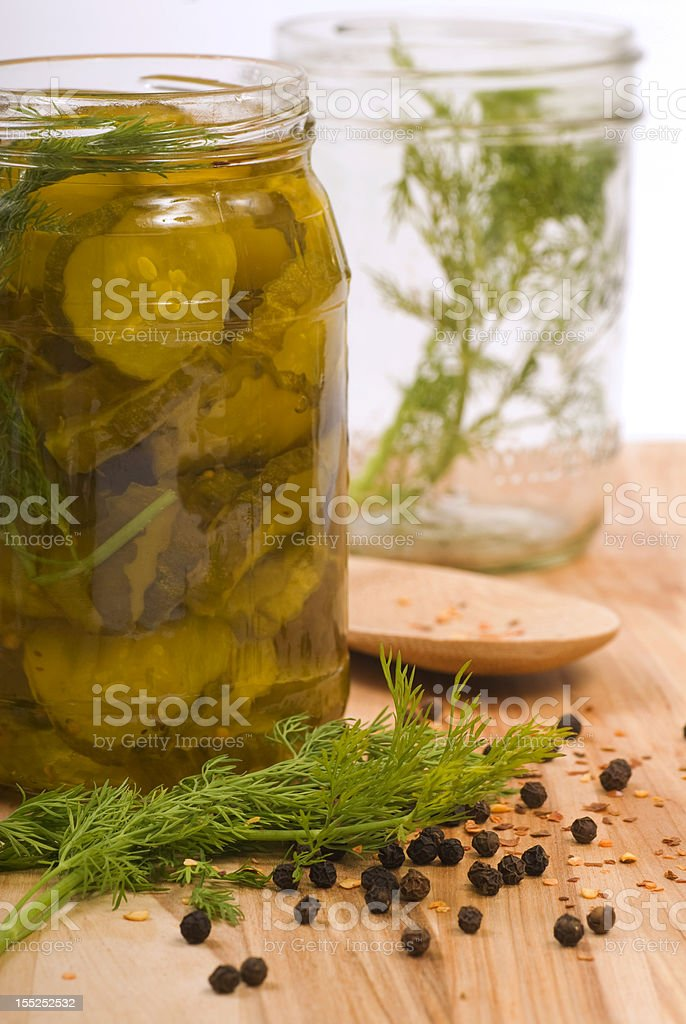 Preserving pickles with dill and peppercorns royalty-free stock photo