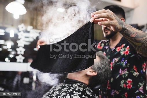 Pre-shave warm towel at barber shop