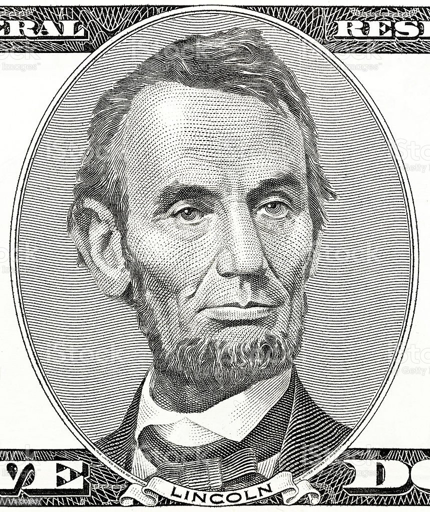 president Abraham Lincoln as he looks on five dollar bill stock photo