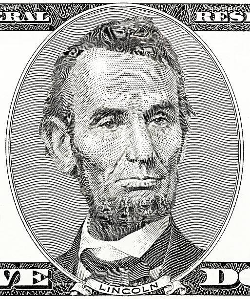präsident abraham lincoln als er sieht auf fünf dollar bill - lincoln united stock-fotos und bilder