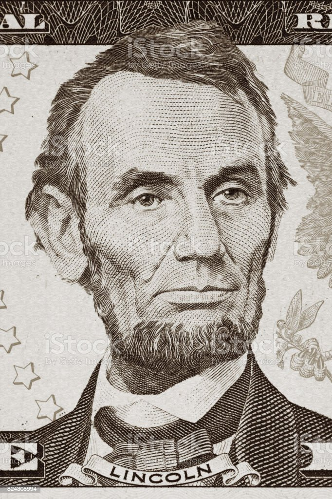 US President Abraham Lincoln portrait on five dollar bill stock photo