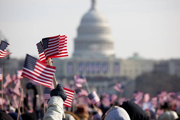 president barack obama's presidential inauguration at capitol building, washington dc - us flag stok fotoğraflar ve resimler