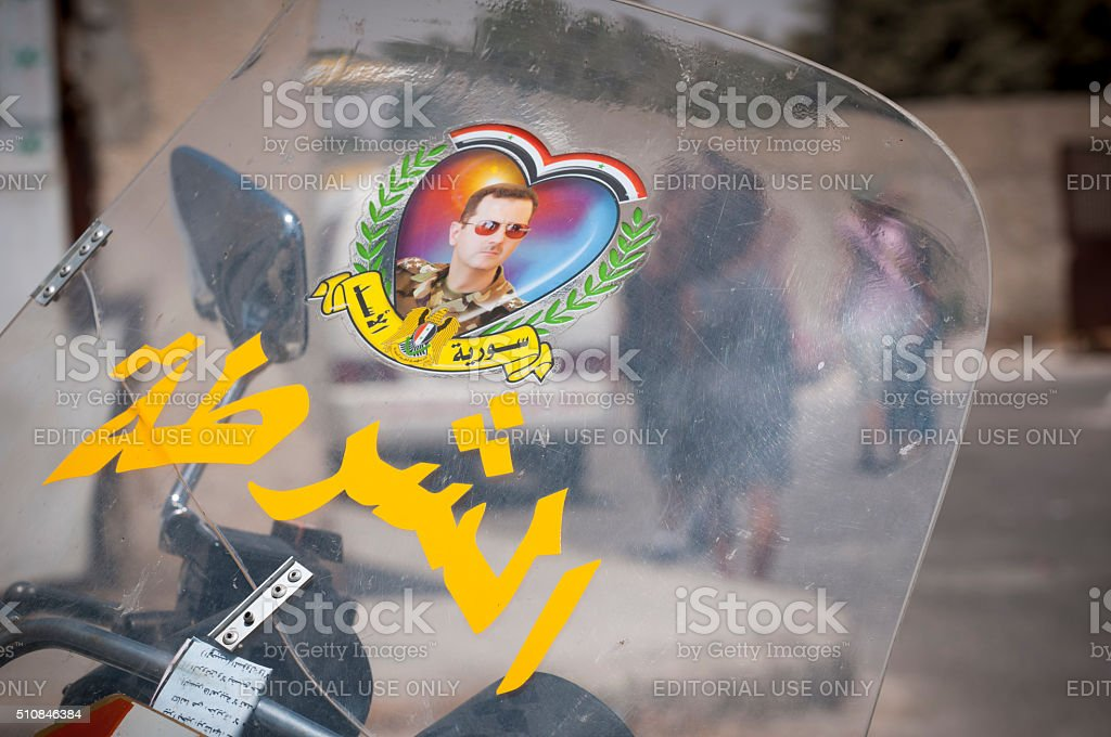 President Bashar al-Assad decal on motorcycle stock photo