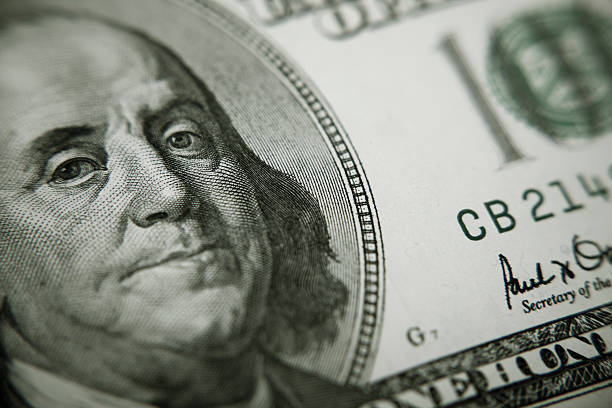President Benjamin Franklin on 100 US dollar bill Benjamin Franklin 100 dollar bill closeup benjamin franklin stock pictures, royalty-free photos & images
