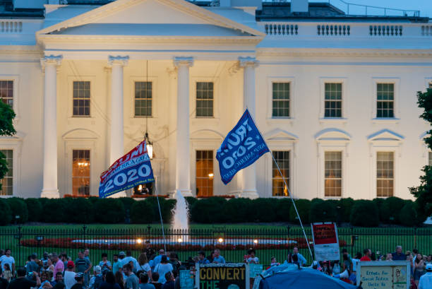 President Donald Trump Supporters and Protesters at White House stock photo
