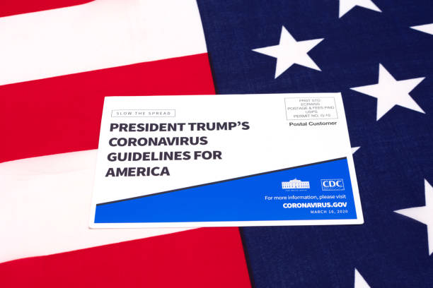 president trump's coronavirus guidelines for america official postcardon us flag - trump стоковые фото и изображения