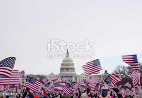 Presidential Inauguration 2013 .  Flag waving spectators throng the Washington Mall near the capital.