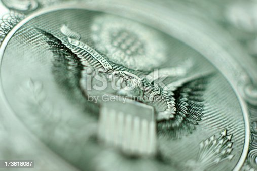 Macro photograph of a U.S. one dollar bill. Focus is squarely on the bald eagle's eye.
