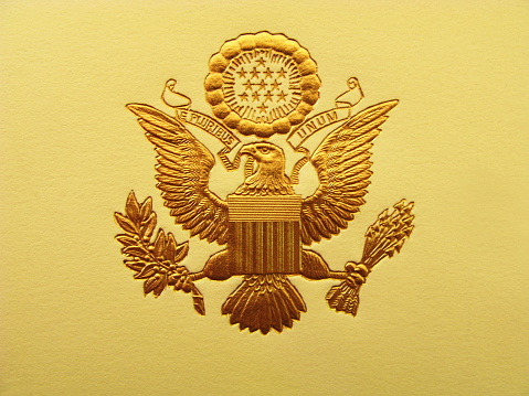 The Seal of the President of the United States is used to mark correspondence from the U.S. president to the United States Congress, and is also used as a symbol of the presidency. The central design, based on the Great Seal of the United States, is the official coat of arms of the U.S. presidency and also appears on the presidential flag.  The stripes on the shield represent the 13 original states, unified under and supporting the chief. The motto (meaning \