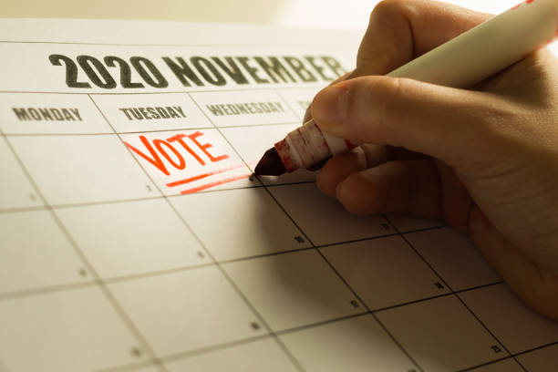 USA Presidential Vote reminder written on a 2020 November calendar. A american vote writing a reminder note on the calender to vote. election stock pictures, royalty-free photos & images