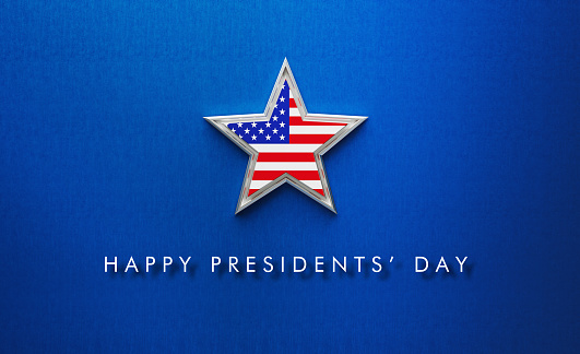 Happy President's Day message written below a silver star textured with American flag on blue background. Horizontal composition with copy space. Directly above. USA President's Day concept.