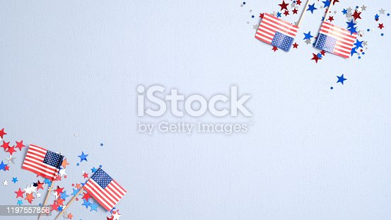 508026042 istock photo Presidents Day or Independence Day USA concept. American flags and confetti stars on blue background. Flat lay, top view. 1197557856