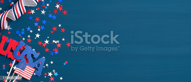 971061452 istock photo Presidents Day USA concept. Festive flat lay style composition with sign USA, grosgrain ribbon in American flag colors and confetti stars. Wide banner template for Independence day or Memorial Day. 1198052835