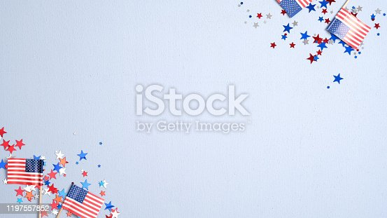 508026042 istock photo Presidents Day USA, Independence Day, US election concept. American flags and confetti stars on blue background. Flat lay, top view. 1197557852