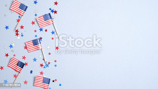 508026042 istock photo Presidents Day USA, Independence Day, US election concept. American flags and confetti stars on blue background. Flat lay, top view. 1197557854
