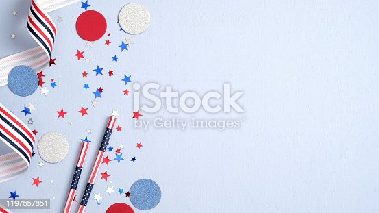 508026042 istock photo Presidents Day USA, Independence Day, US election concept. American national colors ribbon, confetti stars and decorations on blue background. Flat lay, top view. 1197557851