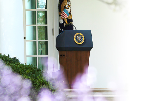 President of the United States Podium, flowers in front copyspace