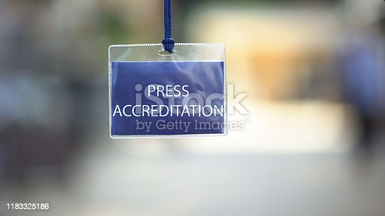 istock Press accreditation pass against blurred background, media ID card during event 1183325186