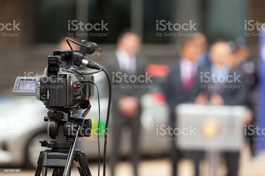 Press conference. Covering an event with a video camera. stock photo