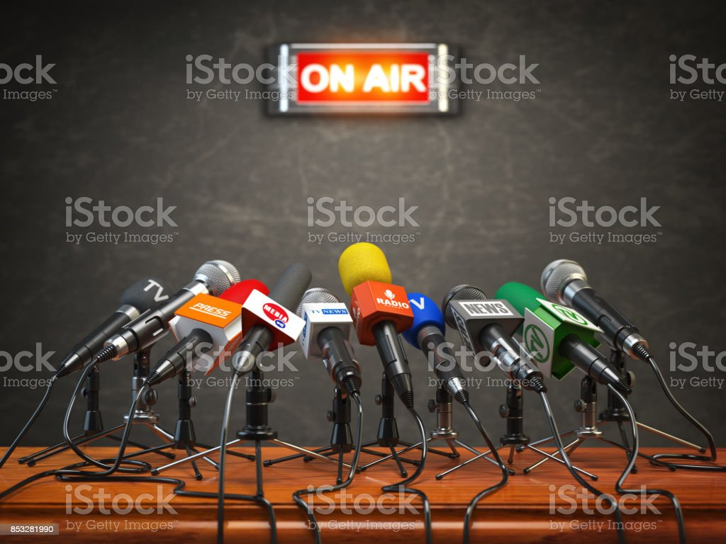 Press conference or interview on air.  Microphones of different mass media, radio, tv and press prepared for conference meeting. stock photo
