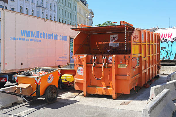Press Container Vienna, Austria - July 11, 2015: Press Container Compactor in Wien, Austria. compactor stock pictures, royalty-free photos & images