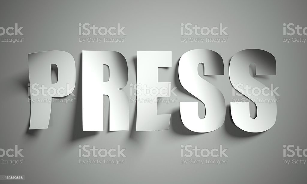 Press cut from paper on background royalty-free stock photo