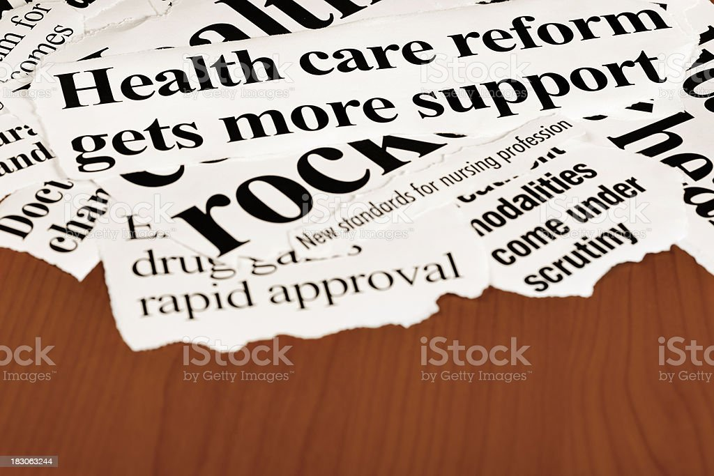 Press cuttings featuring health and medical matters on wooden desk stock photo