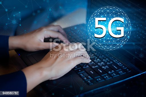 istock 5G 4G Press enter button on the computer. Communication network World map send message Connect worldwide hand keyboard Communications network map of the world Blue map map world global network 948580782