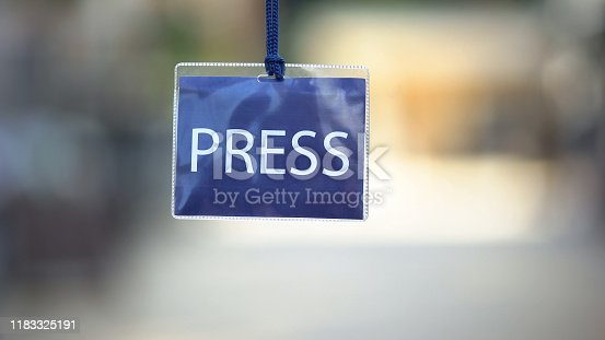 istock Press identification card against blurred background, privilege pass for media 1183325191