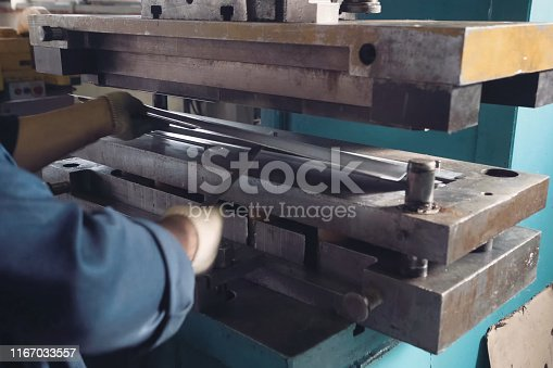 istock press mechanism at the factory, extrusion of parts. 1167033557