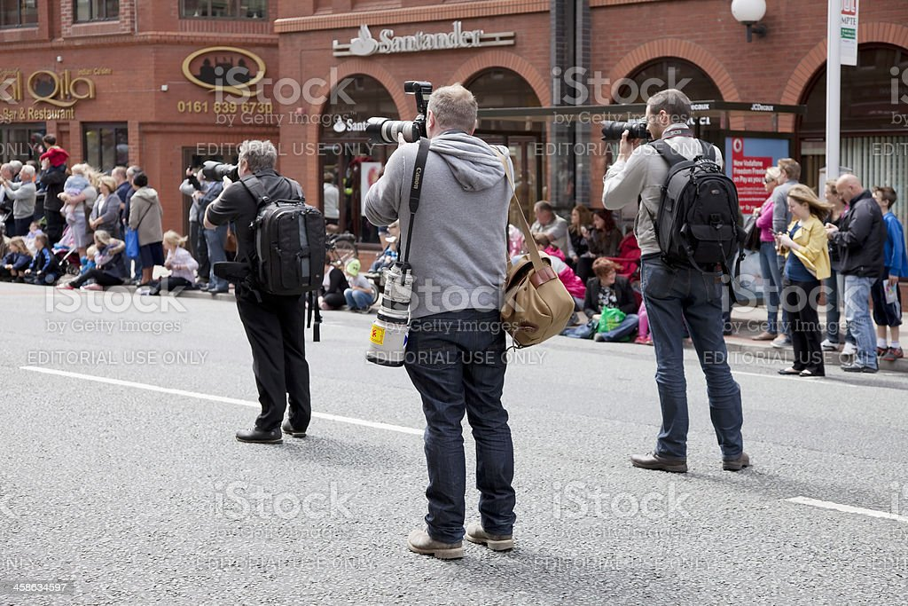 Press photographers and spectators stock photo