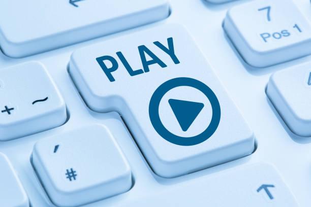 Press Play Button listening music movie internet blue computer keyboard stock photo