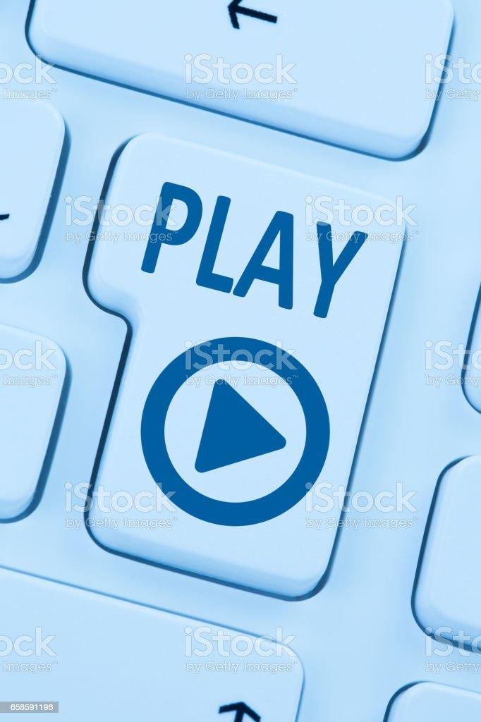 Press Play Button listening music movie internet blue computer web stock photo