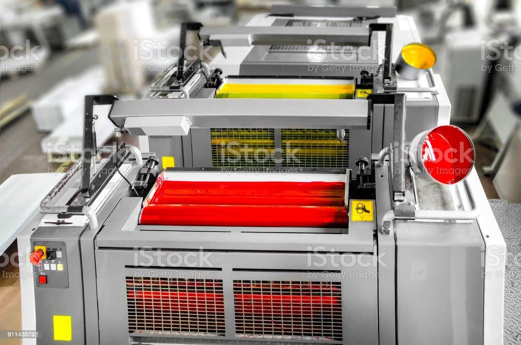 Press printing - Offset machine detail. Magenta and yellow units