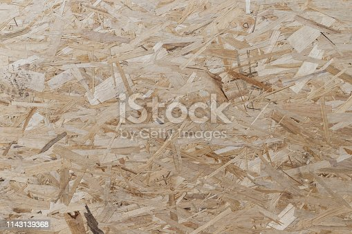 Pressed and glued wood chips. Plywood board Abstract background. Texture of plywood from large wood chips.