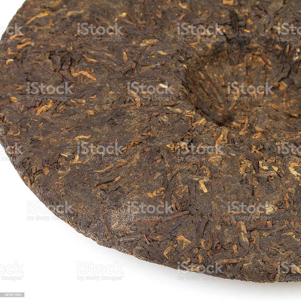Pressed Chinese puer tea isolated on a white background. royalty-free stock photo